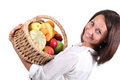 Woman carrying basket full fruit Stock Image