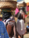 Woman carrying basket on her head weekly market in orissa in chatikona market orissa india Royalty Free Stock Images