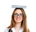 Woman carrying book on her head Royalty Free Stock Photo