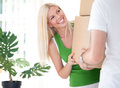 Woman carrying box with boyfriend beautiful her moving day Royalty Free Stock Image
