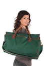 Woman carrying heavy travel bag Royalty Free Stock Images