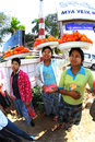 Woman carrying oranges on her head for sell mandalay myanmar january an unidentified burmese the at mandalay myanmar january Stock Photos
