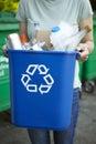 Woman Carrying Recycling Bin Royalty Free Stock Photo