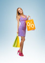 Woman carrying shopping bags Royalty Free Stock Images