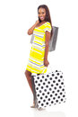 Woman carrying shopping bags beautiful african on white background Stock Photos