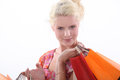 Woman carrying shopping bags blond Stock Photo