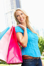 Woman carrying shopping bags in city park Royalty Free Stock Photography