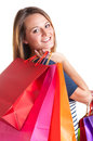 Woman carrying shopping bags isolated in a white background Royalty Free Stock Photos