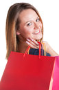 Woman carrying shopping bags isolated in a white background Royalty Free Stock Photography