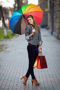 Woman carrying shopping bags outdoor Stock Image