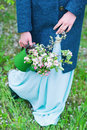 Woman carrying watering pot with blooming branches Royalty Free Stock Photo
