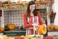 Woman carving jack o lantern on Halloween Stock Photos