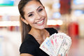 Woman cash casino happy young holding fan of on background Royalty Free Stock Photos