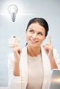 Woman with cash euro money and light bulb Stock Photography