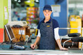 Woman cashier supermarket beautiful working as a at the Stock Photos