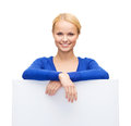 Woman in casual clothes with blank white board people advertisement and sale concept happy Stock Photos
