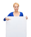 Woman in casual clothes with blank white board people advertisement and sale concept happy Royalty Free Stock Photo