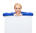 Woman in casual clothes with blank white board people advertisement and sale concept happy Royalty Free Stock Photos