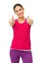 Woman in casuals gesturing thumbs up with both hands portrait of happy over white background vertical shot Stock Images