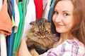 Woman with a cat and clothes in the background Royalty Free Stock Photos