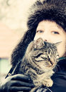 A woman with a cat on her shoulder. photo