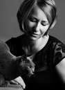 Woman and cat portrait of an adult with her purebred russian blue Royalty Free Stock Photo