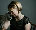 Woman and cat portrait of an adult with her purebred russian blue Royalty Free Stock Image