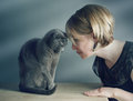 Woman and cat portrait of an adult with her purebred russian blue Stock Images