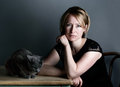 Woman and cat portrait of an adult with her purebred russian blue Stock Photo