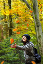 Woman is catching falling leaves Stock Image
