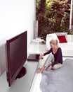 Woman with cd at home and tv Stock Images