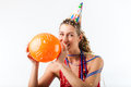 Woman celebrating birthday with balloon Stock Images