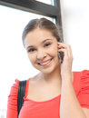 Woman with cell phone bright picture of Royalty Free Stock Image