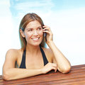 Woman with cell phone in pool Royalty Free Stock Photo