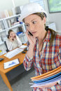 Woman on cellphone inside office Royalty Free Stock Photo