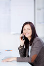 Woman on cellular phone businesswoman sitting the office and calling using a mobile Royalty Free Stock Photo