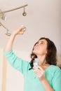 Woman changing light bulb Royalty Free Stock Photo