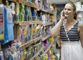 Woman chatting on her mobile while out shopping Royalty Free Stock Photo