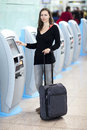 Woman at check in counter attractive checking airport Royalty Free Stock Photography