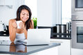 Woman checking emails in the morning Stock Photography