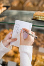 Woman checking her shopping list Royalty Free Stock Photo