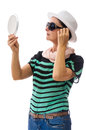 Woman checking herself in mirror with white hat and sunglasses white accessories black sunglasses and hat Royalty Free Stock Images