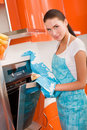 Woman checking how her cookies  in the oven Royalty Free Stock Photo