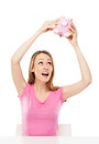 Woman checking piggy bank for money Royalty Free Stock Images