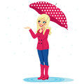 Woman checking rain beautiful blonde holding big umbrella if stops with her hand Stock Photos