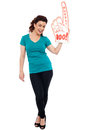 Woman cheering with large boo hurray foam hand Stock Photo