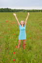 Woman cheering in  poppy field Stock Image