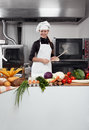 Woman chef professional female having fun and joy in a professional kitchen Stock Photos