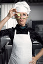 Woman chef professional female with a mustache and a slice of cucumber in a pince nez copies of salvador dali Stock Images