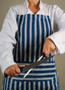 Woman chef sharpening knife Stock Photo